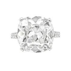 Graff Cushion-cut diamond engagement ring in platinum with partway bead-set, round brilliant cut diamond shanks. Cushion-cut diamond weighing 10.04 carats. Signed Graff.