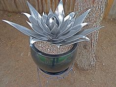"""This aluminum Agave Cactus plant was hand cut, shaped and welded. It measures 22"""" across and stands 14"""" tall. It is for sale!"""