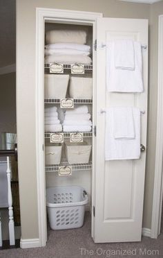 Guest room closet , labels - like the idea of a laundry basket in there for guests to put their dirty linens in