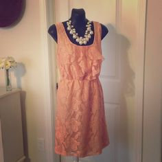 Sleeveless Lace Dress Sweet and simple dress that falls just above the knees. Lace overlay with ruffle top. Color is more peach/blush. Additional pictures available upon request. Maurices Dresses Midi