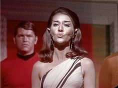 Romulan Commander blows a kiss