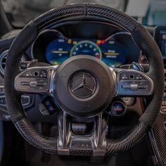 Carbon fiber steering wheel of the Mercedes AMG Photo by - Real luxury c. Lamborghini, Ferrari, Mercedes C63 Amg, Mercedes Truck, C63 Amg Black Series, Dodge Challenger Hellcat, Luxury Cars, Super Cars, Carbon Fiber