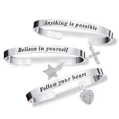 A charming way to show off your personal style. Silvertone open cuff bracelet with a sparkling charm that hangs off the back of the bracelet and a sentiment in black on the front of the bracelet.  One size fits most.