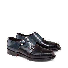 A classic design with a contemporary flavor for this monk strap model with side double-buckle and rounded toes. Made with soft calf leather in dark and elegant tones of black, with a leather sole. The topstitching on the uppers adds modern charm to a timeless style.