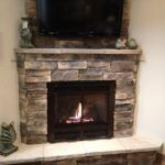 Everybody Happy with Stone Electric Fireplace : Electric Fireplace With Stone Mantel. Electric fireplace with stone mantel. Wood Mantle Fireplace, Stone Mantel, Home Fireplace, Fireplace Remodel, Fireplace Inserts, Living Room With Fireplace, Fireplace Design, Fireplace Ideas, Fireplace Pictures