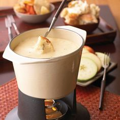 Dunk bread cubes or veggies in this gooey Swiss fondue recipe for a delightful throwback appetizer. For a twist on this simple Swiss cheese fondue recipe, try making it with Gruyere or Emmentaler instead. Fondue Recipes, Dip Recipes, Appetizer Recipes, Appetizers, Fondue Ideas, Recipies, Kabob Recipes, Beef Recipes, Healthy Recipes