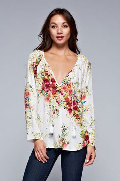 This long sleeve floral print tunic blouse has a drawstring rope tie detail neckline and loose fit.