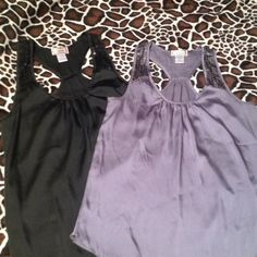 Sequined Racerback Tank Duo Two tanks for the price of one!! Black and silver racerback silky tanks with sequined shoulder detail. Black is large, silver is medium. Both fit similarly- large is a bit longer. Perfect for a night out. Tops Tank Tops