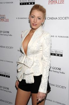 Blake Lively wears a white Marchesa jacket