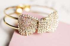 Gorgeous crystal bow bracelet adds the perfect touch to any outfit! Hinge bangle.