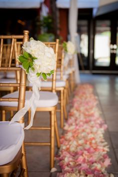 petal lined aisle with pew hangs photo: Katie Joyner Photography flowers Kiwi Fleur planning First City Events: Brittany and Steven's Mansion on Forsyth Park Wedding