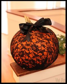 I just had do dress up one of my pumpkins in black lace this year! Simply cut a little hole for the stem and then use black duct tape to at...