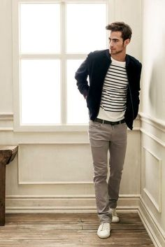 Dark blue jacket, stripe shirt, grey jeans, white shoes