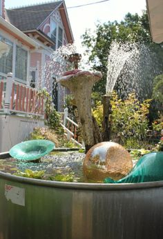 Fredda, Fredda, Fredda - garden fountain with glass balls, bowls and vintage instruments
