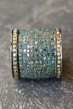 RONA PFEIFFER Blue diamond cigar band ring: 4.72 ct blue pave diamonds and 0.96 ct yellow pave diamonds