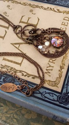 This beautiful Bella Vintaj necklaces is a collection of swarvoski, czech glass and pearl with intricately detailed natural brass. Vintage quality.