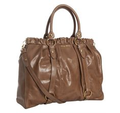 Miu Miu cinnamon glazed tote.  It has a ruffle and is cinnamon-colored. Which is totally worth the $1200 price tags...no?