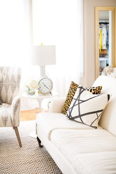 Patterns on living room sofa pillows and chevron rug // leopard print