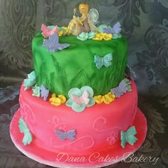 A garden fairy cake for an awesome little girl who had a fairy dance party with her friends. After covering each tier with fondant, they were airbrushed to achieve those beautiful vibrant colors. The designs on each tier were hand painted. The flowers and butterflies are all edible fondant. I am happy to say that this birthday girl loved her cake!!