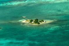 Hat Caye is acre island located within the calm waters of the Lighthouse Reef Atoll, one of only. Caribbean Homes, Central America, Belize, Lighthouse, Acre, Islands, Waves, Hat, Outdoor