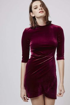 It's not a party unless you're wearing velvet. Our burgundy wrap over dress is party perfect. #Topshop