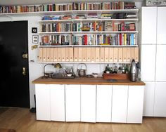 Wall of storage made from Elfa shelves and IKEA kitchen cabinets.