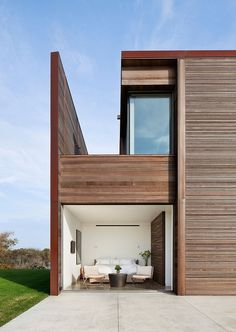 Bates Masi Architects designed this spacious minimalistic coastal residence located in Sagaponack, New York, for a large family and their numerous guests.