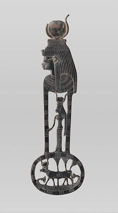 An ancient Egyptian menat counterpoise with figures of Hathor as a woman and a cow; 'The menat symbolised Hathor, and, as such, 'brought fertility, fostered the newly born and rebirth in the afterlife. (Metropolitan Museum of Art)