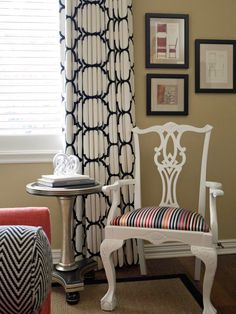 A coat of glossy white or black paint can take an otherwise dull piece of furniture to sassy new heights. For example, designer Emily Johnston Larkin of EJ Interiors treated an uber-traditional dining chair to a new finish, making it the perfect complement to the black and white lattice-print window treatments and zig-zag-printed bolster pillows.