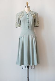 Dress: ca. 1940's, filigree lace, floral lace applique, rayon, floral buttons.