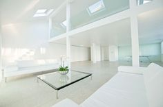 ALL WHITE MINIMAL WAREHOUSE SPACE WITH LIMESTONE FLOORING