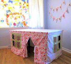 Playhouse slipcover to put over a small table to make a fort. Absolutely love this idea!