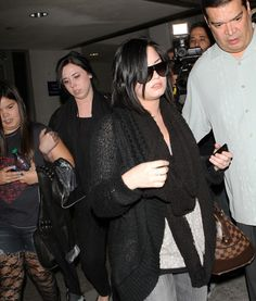 Demi Lovato Photos - Actress Demi Lovato shields her face as she arrives on a flight at LAX airport in Los Angeles. The actress has sprained her ankle. Demi recently donated million dollars to the Japan tsunami relief. - Demi Lovato Arriving At LAX Airport Tsunami, Demi Lovato, Leather Jacket, Actresses, People, Japan, Ankle, Photos, Studded Leather Jacket