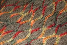 This afghans colors are reminiscent of fall leaves in North Carolina. Perfect for crisp fall & winter weather. Works well as a lap blanket