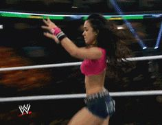 AJ Lee goes into her Black Widow submission move. I wanna do the twisty part! but i can still put in the submission move!