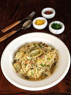 Lemon Butter Pasta with Artichokes and Capers - A delicious spring-inspired, easy and flavorful recipe for meatless meal by Tori Avey. via @toriavey