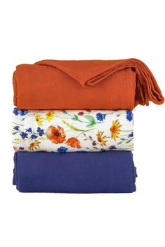 Floral baby blanket set. Vintage - Tula Baby Blanket Set. Some things will always leave you awestruck... like a field of flowers covering a hillside or the first precious days after you meet your baby. The feeling is warm, poignant and everlasting. 'Vintage' has a meadow of colorful wild flowers tossed across a white background. This ultra soft, viscose bamboo baby blanket comes as a three blanket set with two jacquard weave blankets, in shades of cinnamon and indigo, that have have a…