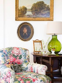 The living room's art is an eclectic mix of local finds, such as the Mary H. Case painting above the fireplace, and cherished family heirlooms.