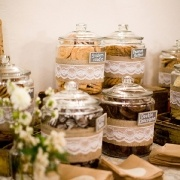 """Cookie bar, """"say I do to milk and cookies"""" favors. Bags to take home, individual milk cartons in galvanized tub."""
