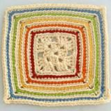Learn How to Crochet This Colorful Granny Square: Crocheted Granny Square With Rainbow Outlines