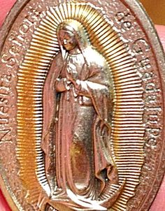 $44 Our Lady of Guadalupe - A Large 2 inch long silver oxidized metal pendant with gold embellishment featuring the Blessed Mother. Lovely detail on this one! great size for men too! The back reads : Pray For Us and is marked ITALY.