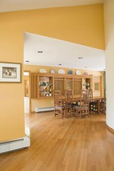 Warm-toned expanses of yellowish, natural white oak display an orange-brown glow when flooring is stained and polished. Cooler and pinkish, red oak's undertone -- or underlying hue -- remains ...