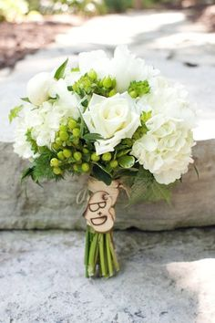 Alternative Wedding Bouquets. An engraved wooden charm is an inexpensive way to personalize a rustic wedding's flowers