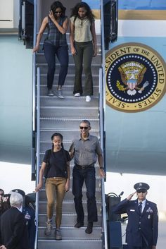 President Barack Obama and daughter Malia exit Air Force One ahead of daughter Sasha and first lady Michelle Obama as they arrive at Castle Airport in Atwater before boarding Marine One for Yosemite National Park on Friday, June 17, 2016.