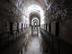 Eastern State Penitentiary in Philadelphia, Pennsylvania, one of the oldest standing prisons and former home to Al Capone. Abandoned Prisons, Abandoned Buildings, Abandoned Places, Abandoned Property, Abandoned Castles, Most Haunted, Haunted Places, Spooky Places, Haunted Houses