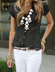 Love the black sheer short sleeve blouse with white jeans!