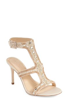 Crystal and bead embellishments make this satin T-strap sandal sparkle for an elegant look.