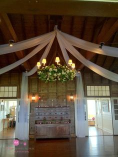 Custom Tulle Ceiling for a wedding at the Sankaty Gold Club. Read more about our Custom Design Services on the blog: http://blog.soireefloral.com/2014/03/soiree-floral-and-dawn-kelly-designs.html #dawnkellydesigns #soireefloral #tulle