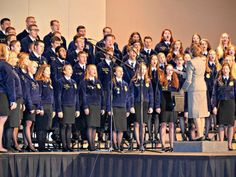 The National FFA Choir sings the national anthem. The group performed several times throughout the convention, along with the National FFA band.