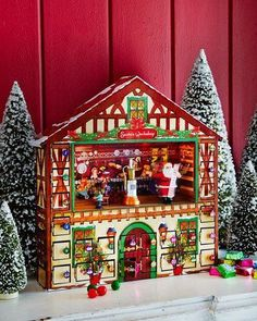 Animated Advent House. Musical advent house with animated Santa scene. 24 doors behind which treats may be hidden. When a door is opened, the scene in the center of the house lights up, the figures turn, and music plays; a new song plays each time a door is opened. Plays 25 Christmas carols.  {affiliate link}